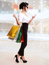 Portrait of happy woman with color shopping bags. Royalty Free Stock Images