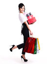 Portrait of happy woman with color shopping bags full and boxes standing isolated on white background Royalty Free Stock Photo