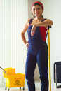 Portrait Of Happy Woman Doing Chores Cleaning Floor At Home Royalty Free Stock Photo