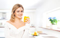 Portrait of a happy woman drinking orange juice young and beautiful girl fresh Stock Image