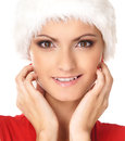 Portrait of a happy woman in a fur Christmas hat Stock Image