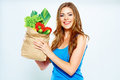 Portrait of happy woman with green vegan food in paper bag white background Royalty Free Stock Photos