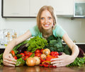 Portrait of happy woman with heap of vegetables Royalty Free Stock Photo