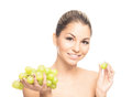 Portrait of a happy woman holding grapes close up beautiful fresh healthy and sensual girl eating isolated on white Stock Photography