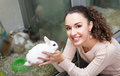 Portrait of happy woman holding rabbit