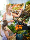Portrait of happy woman and kid shopping Royalty Free Stock Photo