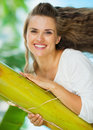 Portrait of happy woman leaning on tropical palm Royalty Free Stock Photos