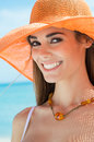 Portrait of a happy woman at the sea close up smiling girl with hat Stock Image
