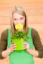 Portrait happy woman smell yellow spring flower Stock Photography
