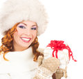 Portrait of a happy woman in a winter hat holding a present young and christmas the image is isolated on white background Royalty Free Stock Image