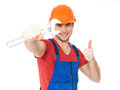 Portrait happy worker spanner showing thumbs up sign isolated white background Stock Photography