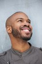 Portrait of a happy young african american man smiling close up and looking up Stock Photo