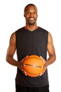 Portrait of a happy young basketball player isolated on white Stock Photography