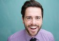 Portrait of a happy young business man laughing close up Royalty Free Stock Image