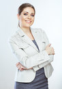 Portrait of happy young business woman crossed arms against whi white background Stock Photo