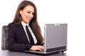 Portrait of a happy young business woman using laptop against white background Stock Photo