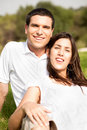 Portrait of Happy young couple sitting and smiling Royalty Free Stock Photos