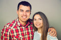 Portrait of happy young couple studio on gray background Stock Photography