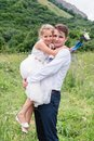 Portrait of a young father with his daughter in his arms Royalty Free Stock Photo