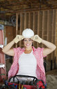 Portrait of a happy young female contractor wearing hardhat at construction site Stock Image