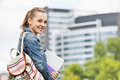 Portrait of happy young female student at college campus Royalty Free Stock Photo