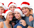 Portrait of happy young friends celebrating Christ Stock Photo