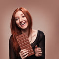 Portrait happy young girl with the big chocolate of Stock Photos