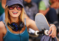 Portrait of a happy young girl with skateboard Stock Photography