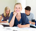Portrait of happy young girls writing notes Stock Images