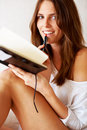 Portrait of a happy young lady with a book Royalty Free Stock Photo