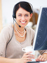 Portrait of a happy young lady with headset Royalty Free Stock Image
