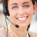 Portrait of a happy young lady with headset Royalty Free Stock Photos