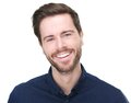Portrait of a happy young male model smiling Royalty Free Stock Photo