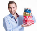 Portrait of happy young man with gifts isolated on white Royalty Free Stock Photos