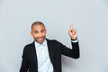 Portrait of a happy young man pointing finger up Royalty Free Stock Photo
