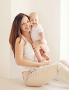 Portrait of happy young mother and baby having fun together Royalty Free Stock Photo