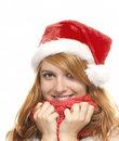 Portrait of a happy young redhead woman with santa Stock Photo
