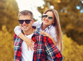 Portrait happy young smiling couple having fun together outdoors in warm autumn day Royalty Free Stock Photo