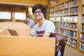 Portrait of happy young student using his laptop Royalty Free Stock Photo