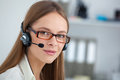Portrait of happy young support phone operator with headset. Royalty Free Stock Photo