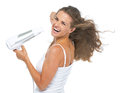 Portrait of happy young woman blow dry isolated on white Stock Photography