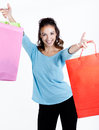 Portrait of happy young woman carrying shopping bags stunning against white background Royalty Free Stock Photography