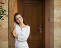 Portrait of happy young woman at doorstep Stock Photos
