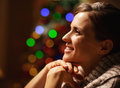 Portrait of happy young woman in front of christmas lights high resolution photo Stock Photography