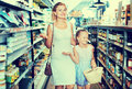 Portrait of happy young woman and girl gladly shopping Royalty Free Stock Photo