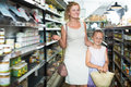 Portrait of happy young woman and girl shopping Royalty Free Stock Photo