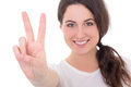Portrait of happy young woman giving peace sign isolated on whit white background focus hand Royalty Free Stock Photos