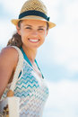 Portrait of happy young woman in hat and with bag pretty white Royalty Free Stock Image
