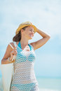 Portrait of happy young woman with hat and bag on sea shore pretty white Royalty Free Stock Image