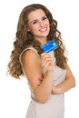 Portrait of happy young woman holding credit card isolated on white Stock Images